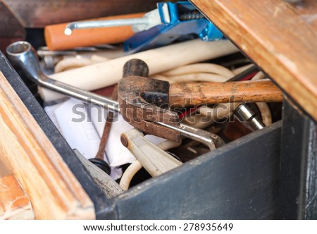Close up of rusty hammer in tool box for repair background - stock photo