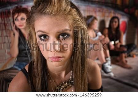 Close up of sad blond girl near friends - stock photo