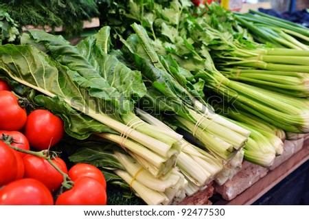 close up of salad and tomatoes on market stand - stock photo