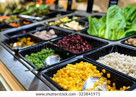 Close up of salad bar in supermarket - stock photo