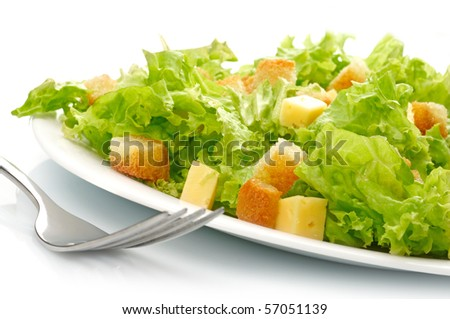 Close-up of salad on white plate - stock photo