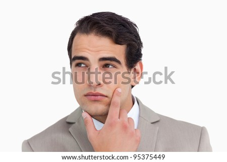 Close up of salesman in thoughts against a white background - stock photo