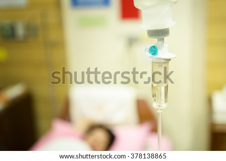 Close up of saline with woman patient on bedroom in  hospital