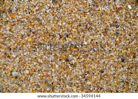 Close up of sand and or tiny rocks. - stock photo