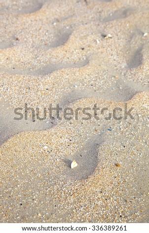 Close up of sand on sunny beach - stock photo