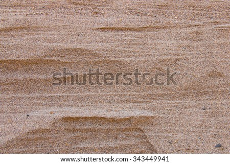 Close up of sand pattern of a beach in the summer. Quarry sand wall close up. Sand background - stock photo