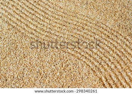 Close up of sand zen garden - stock photo