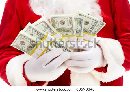 Close-up of Santa?s hands with stacks of dollar banknotes - stock photo