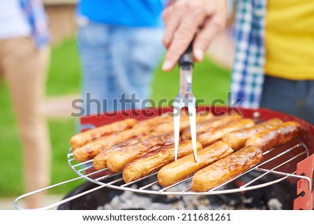 Close-up of sausages on grill - stock photo