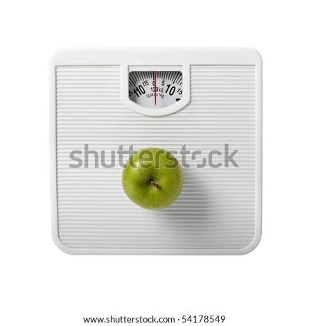 close up of scale and apple on white background with clipping path - stock photo
