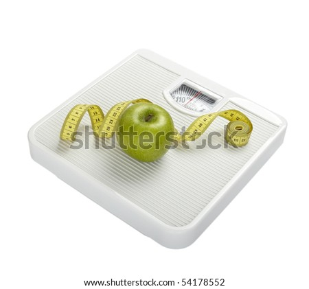 close up of scale, tape and apple on white background with clipping path - stock photo