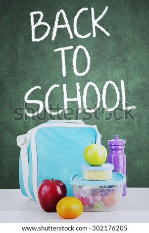 Close up of school lunch for child back to school, shot in the classroom with blackboard background - stock photo
