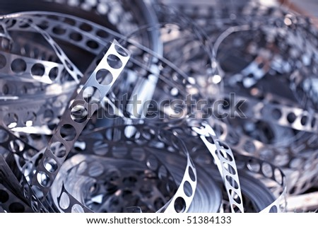 Close-up of scrap metal from stamping production line, blue toned. - stock photo