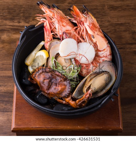 Close up of seafood in Iron bowl,  Korean food - stock photo