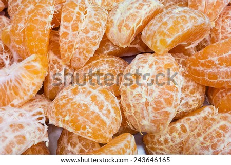 Close Up of Sections of Tangerine Arranged Randomly. With White Mesh on Sections of Tangerines. - stock photo