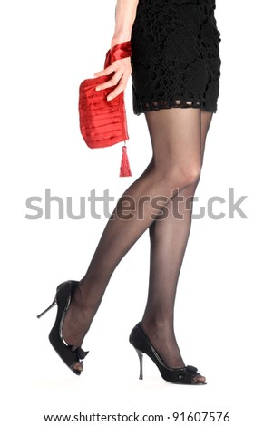 Close-up of seductive young woman's legs in high-heeled black shoes isolated on white - stock photo