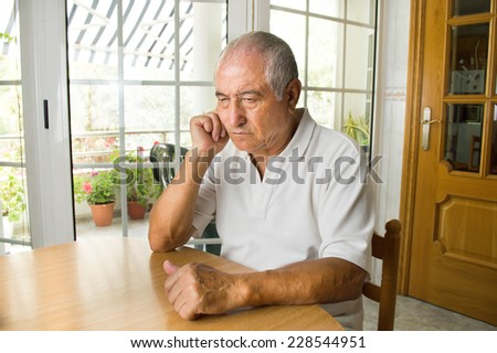 close up of senior man ost in thought - stock photo