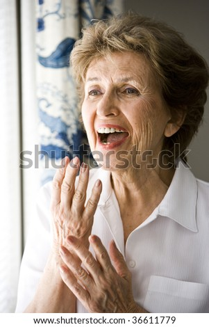 Close up of senior woman laughing
