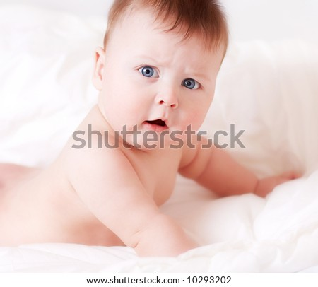 close up of serious baby boy on white background - stock photo