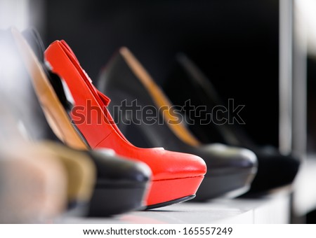 Close up of set of heeled shoes at the showcase in the shopping mall - stock photo