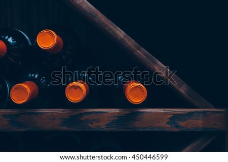 Close-up of several bottles of wine in row. Useful as a background - stock photo