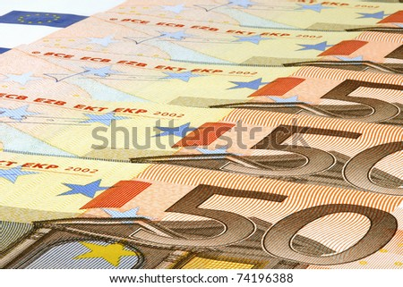 Close-up of several fifty euro banknotes. - stock photo