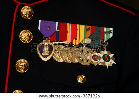 Close-up of several military medals including a Purple Heart on a dark blue dress Marine uniform - stock photo