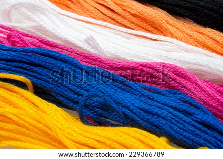 close-up of several strands of soft colored cotton - stock photo