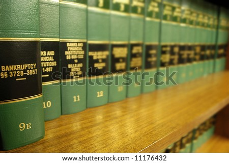 Close up of several volumes of law books of codes and statutes