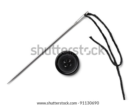 close up of  sewing items on white background - stock photo