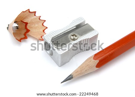 close up of sharpener and red pencil on white background, with clipping path, shadow not included - stock photo