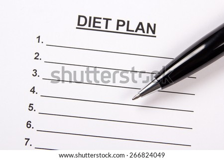 close up of sheet of paper with diet plan and metal pen - stock photo