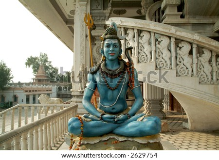 close up of shiva statue chattapur mandir temple new delhi india - stock photo