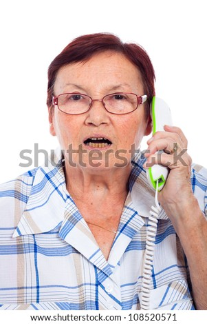 Close up of shocked senior woman on the phone, isolated on white background.
