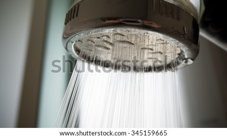 Close up of shower head in a bathroom - stock photo
