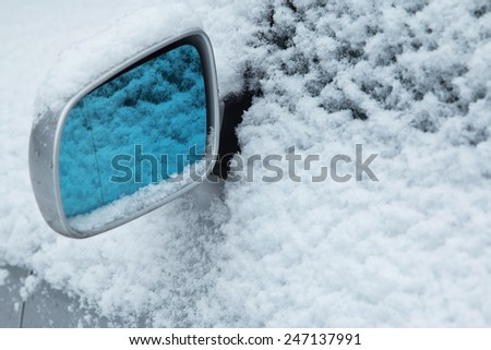 Close up of side car mirror and snow - stock photo