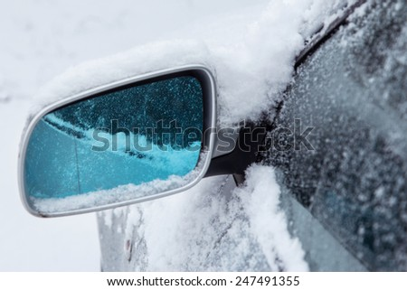 Close up of side car mirror and snow