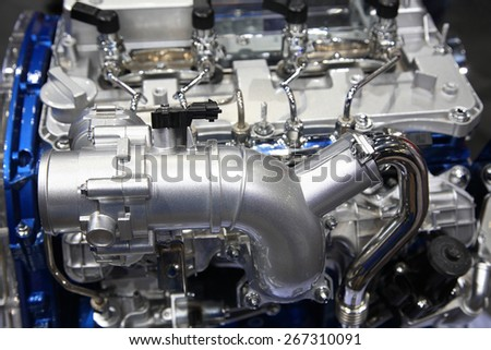 Close up of silver chrome car motor engine - stock photo