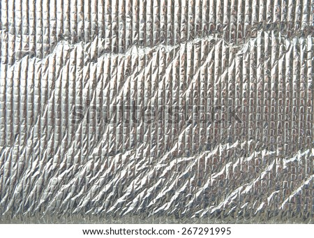 Close up of silver foil insulation - stock photo