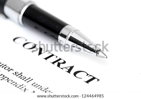 Close-up of silver pen on contract.