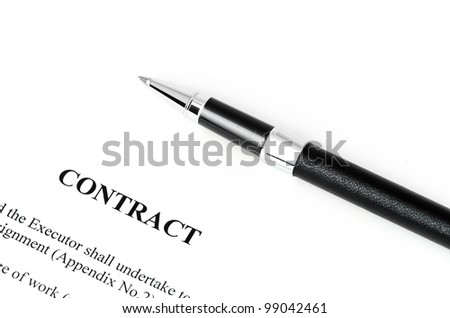 Close-up of silver pen on contract. Selective focus on top of pen. - stock photo