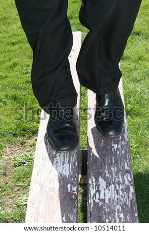 close-up of single man standing on park bench