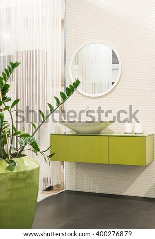 Close up of sink in bathroom interior - stock photo