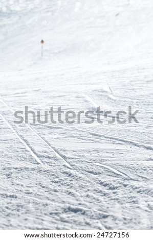 Close up of ski slope with numerous trails