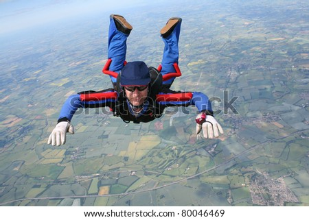 Close-up of skydiver in freefall - stock photo
