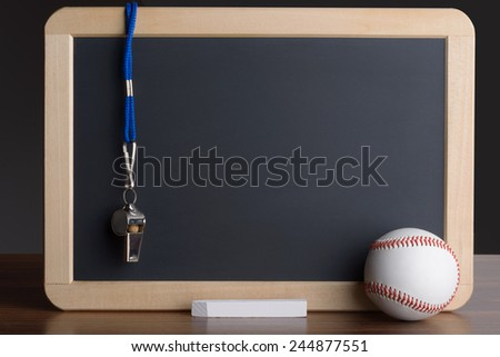 Close-up Of Slate With Baseball; Chalk And Whistle - stock photo