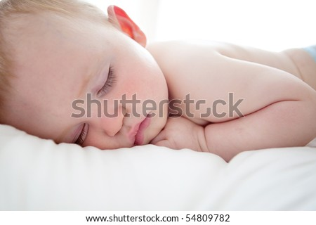 Close up of sleeping baby - stock photo