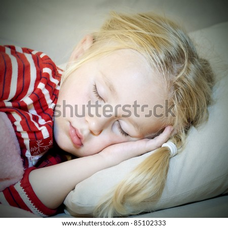 Close up of sleeping little girl - stock photo