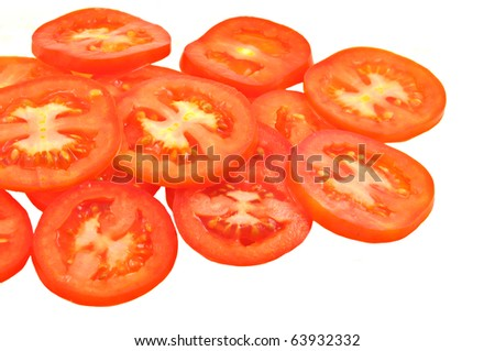close up of slices of ripen tomato piled on white background - stock photo