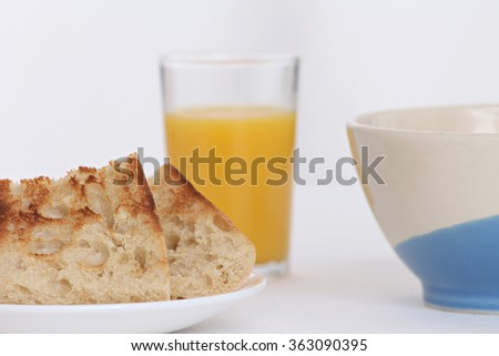 close-up of slices of toast and a breakfast full of vitamins with orange juice